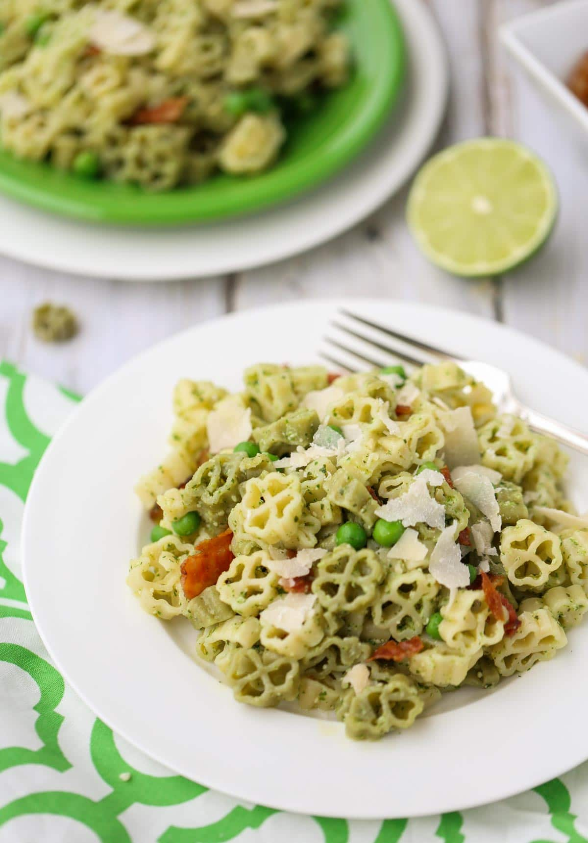 Arugula and Lime Pesto Pasta | A tangy and delicious combo for pesto! Add bacon, green peas, and make it your own! Yum! | WorldofPastabilities.com