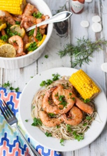 Bayou Shrimp Pasta | WorldofPastabilities.com | Zesty Cajun Bayou Shrimp Pasta is the must do beach recipe! Simple to make it delivers a ton of flavor. Get messy and have fun with the entire family!