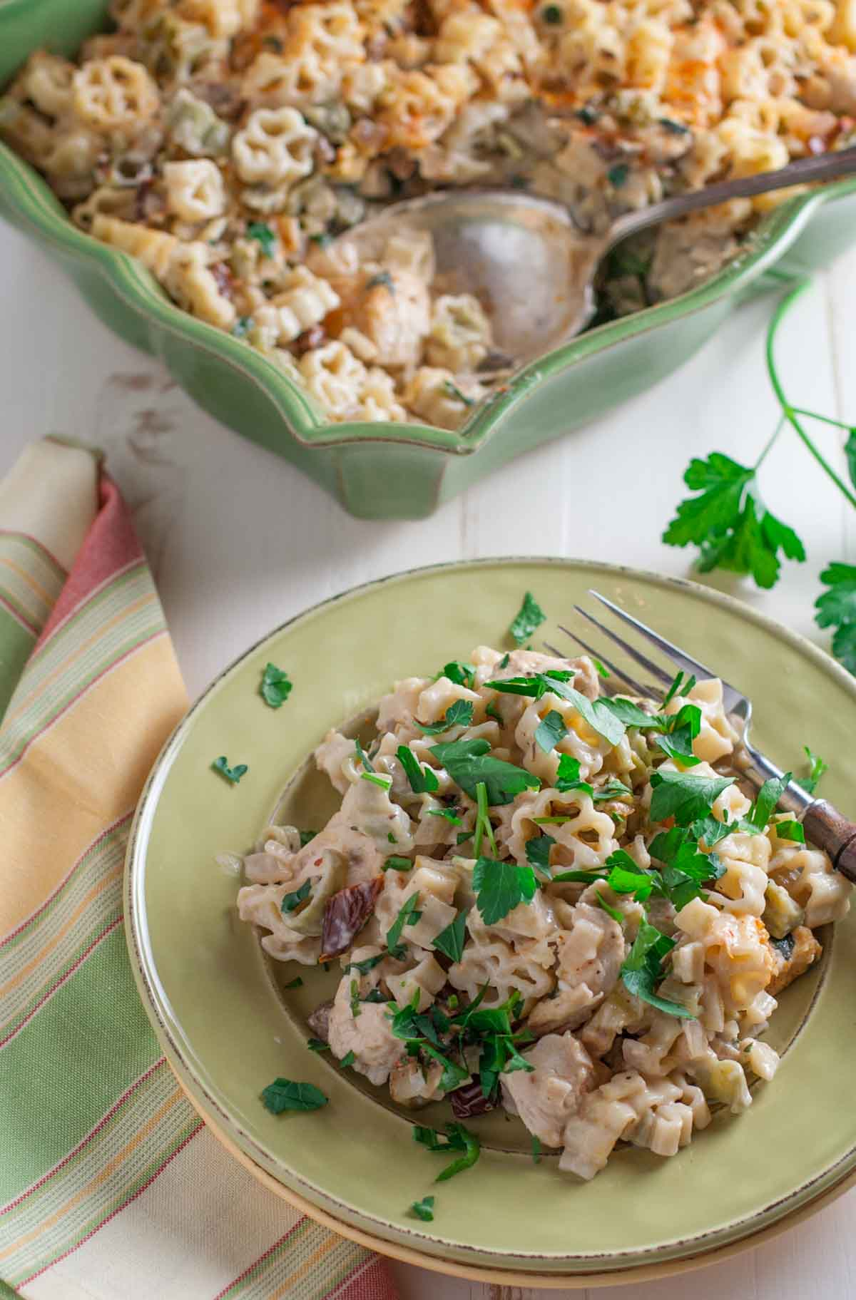 Creamy Chicken and Sun Dried Tomato Pasta   WorldofPastabilities.com   Delicious updated chicken casserole with bursts of flavor! Can be made ahead or frozen for later. Yum!