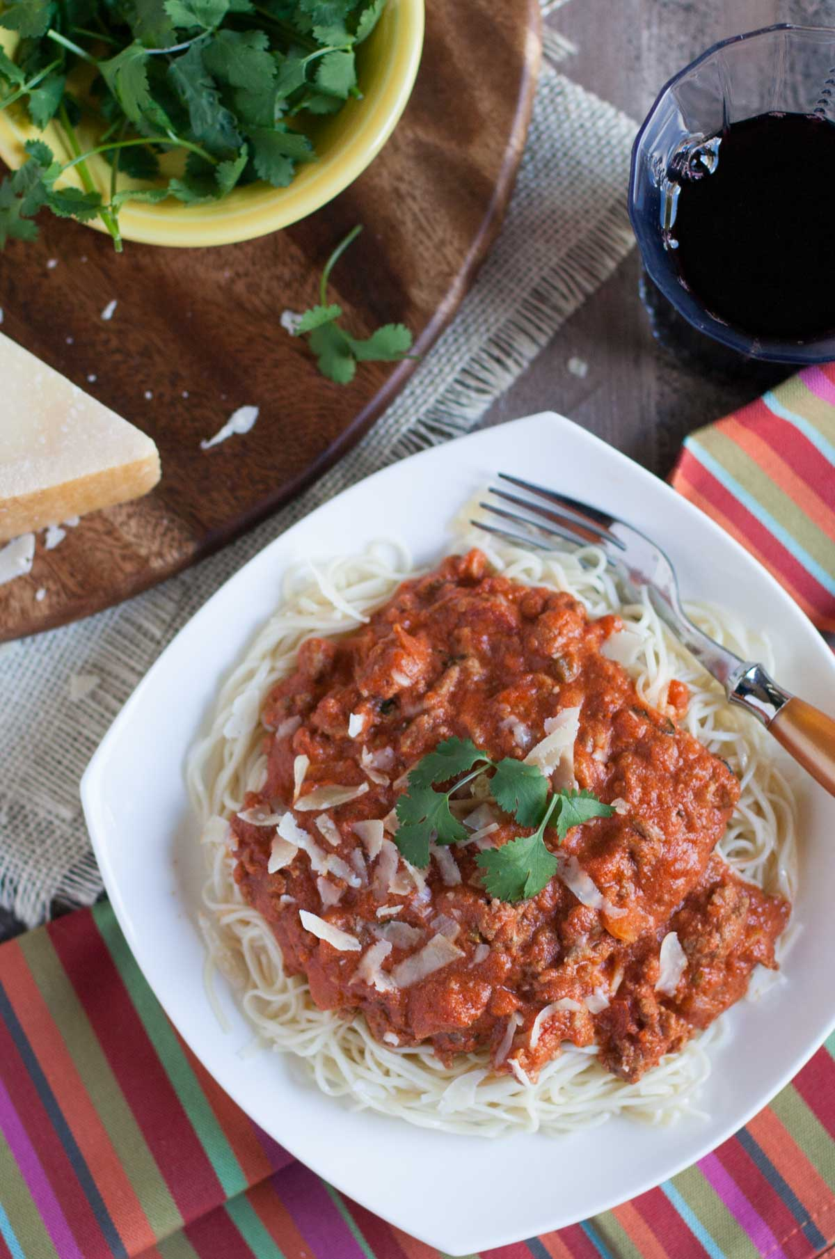 Creamy Taco Bolognese | WorldofPastabilities.com | Flavorful combo of traditional bolognese with fresh jalapenos, cilantro, taco seasoning, and sour cream...your taste buds and family will thank you!