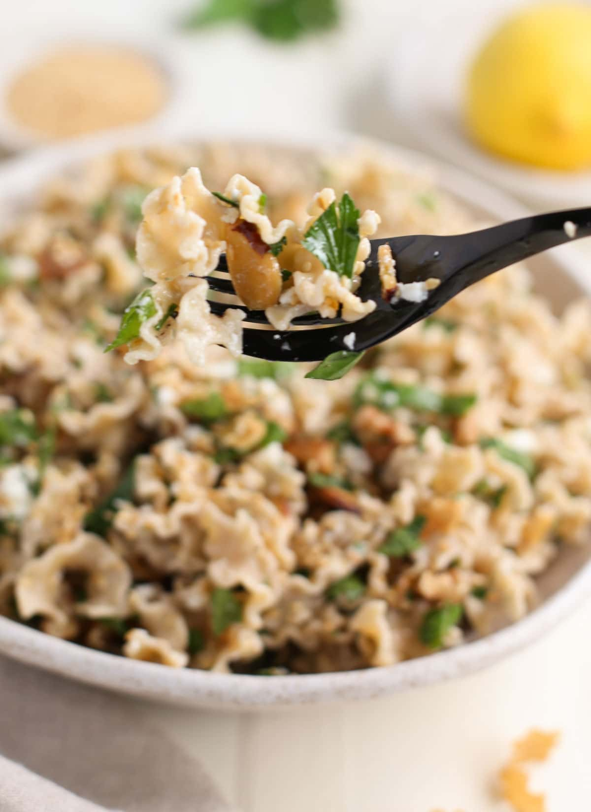 One forkful of Good Day Pasta with Toasted Nuts and Feta