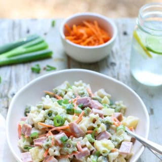 Hawaiian Pasta Salad | WorldofPastabilities | Sweet summer pasta salad combines pineapple, ham, carrots, and green onions with a deliciously fresh dressing! Perfect for a grill night or served with a summer picnic!