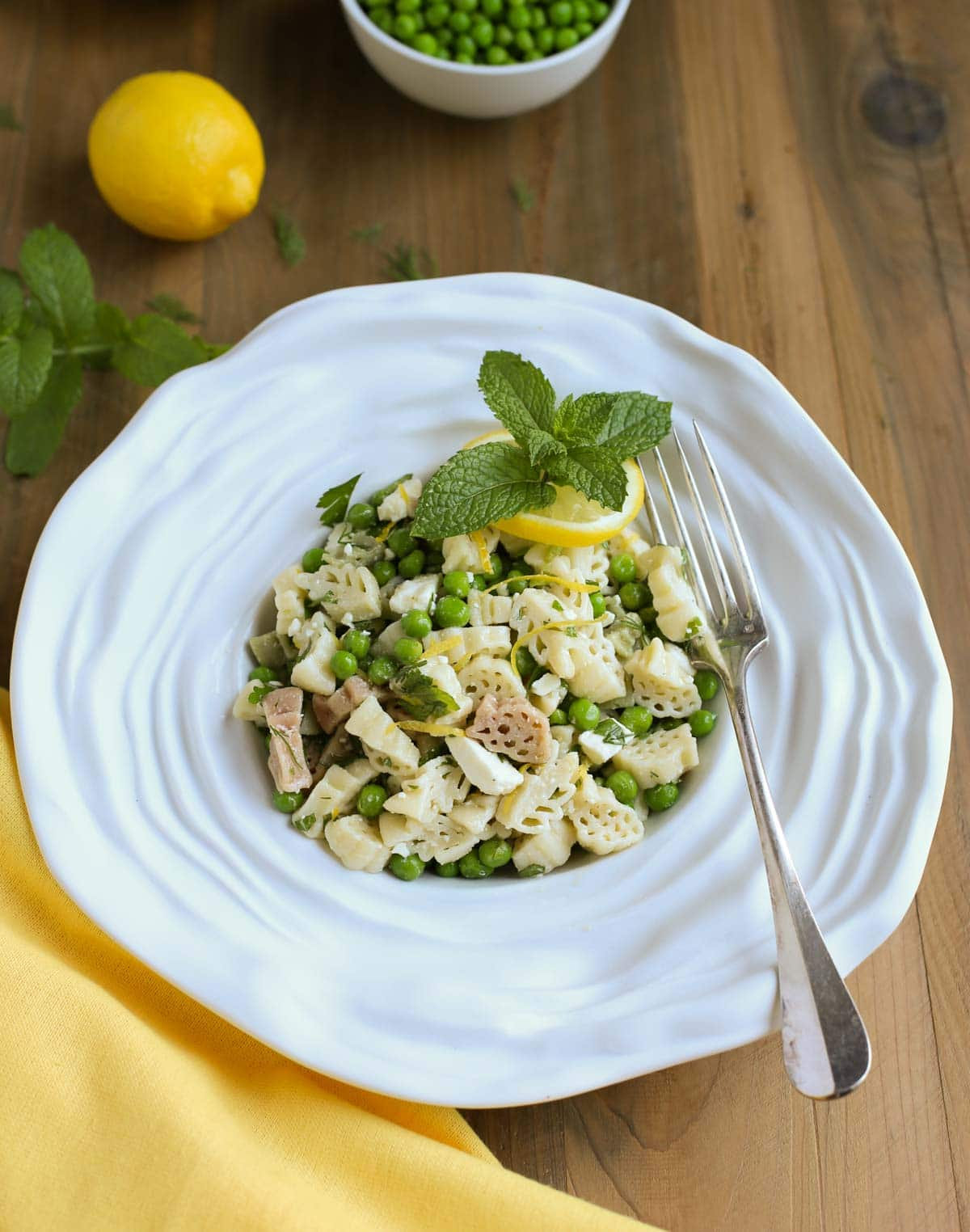 Light and Herby Mediterranean Pasta Salad | Lemon, Feta, and Fresh Chopped Herbs make this a light and delicious side dish! A tangy vinaigrette dressing ties it all together...yum! Great with any grilled meats or seafood! | WorldofPastabilities.com