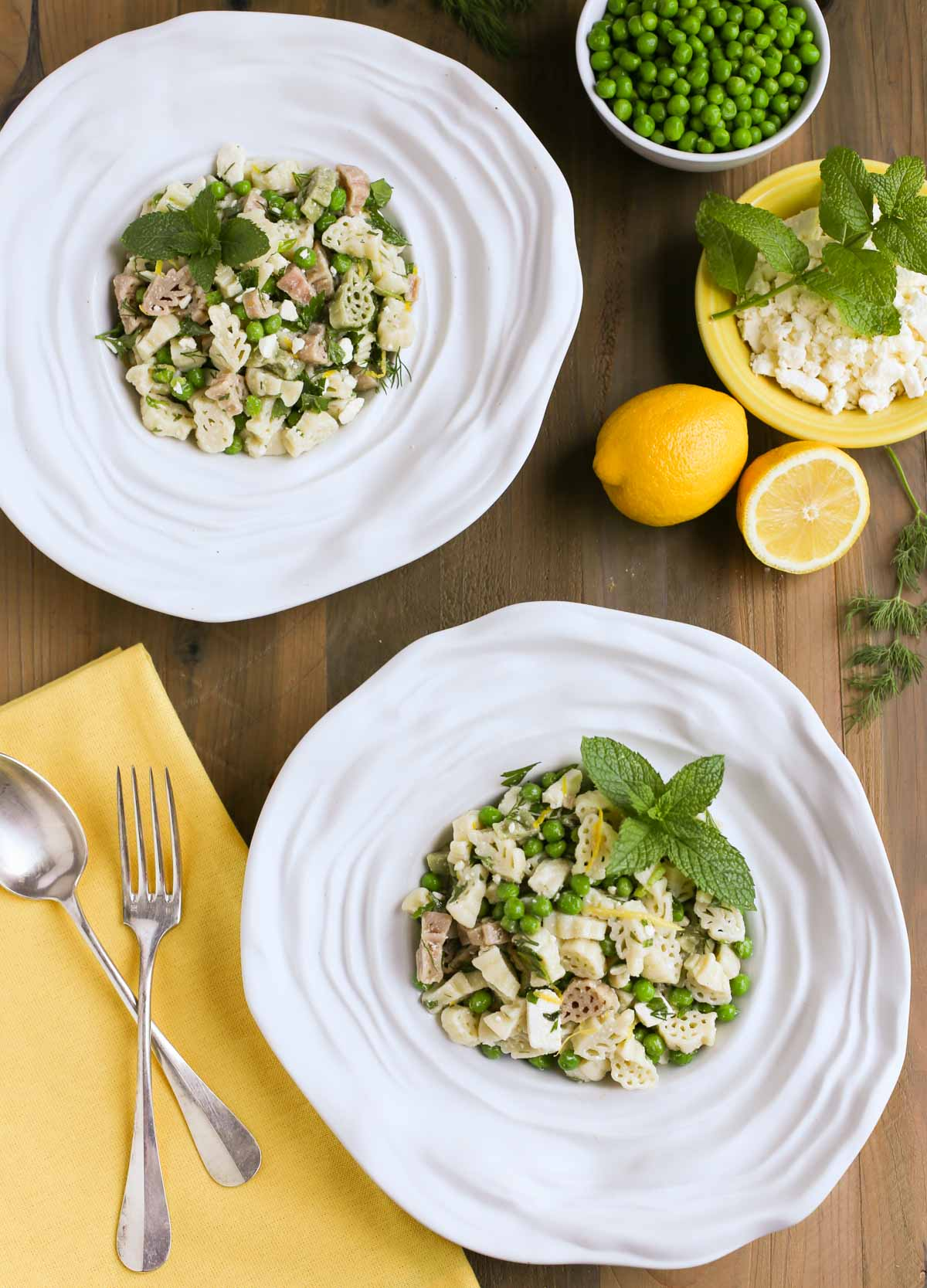 Light and Herby Mediterranean Pasta Salad   Lemon, Feta, and Fresh Chopped Herbs make this a light and delicious side dish! A tangy vinaigrette dressing ties it all together...yum! Great with any grilled meats or seafood!   WorldofPastabilities.com