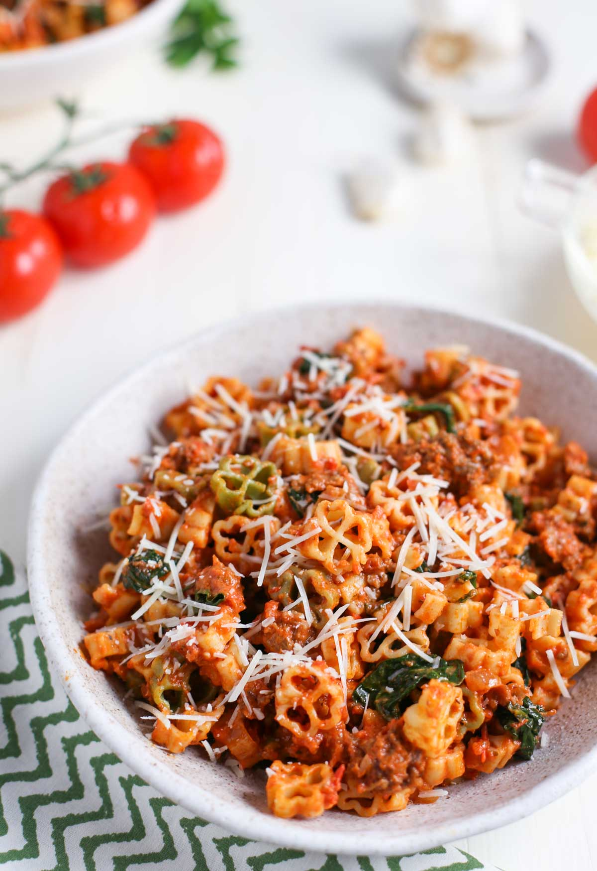 Side view of Pasta with Spicy Sausage and Tomato Cream Sauce with fresh tomatoes