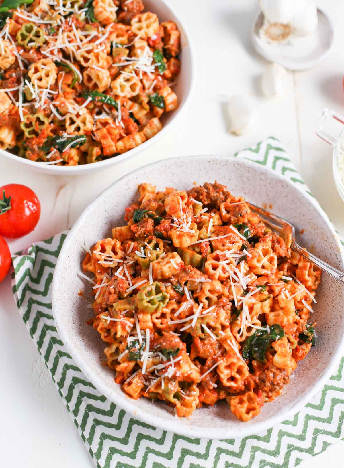 Two bowls of Pasta with Spicy Sausage and Tomato Cream Sauce