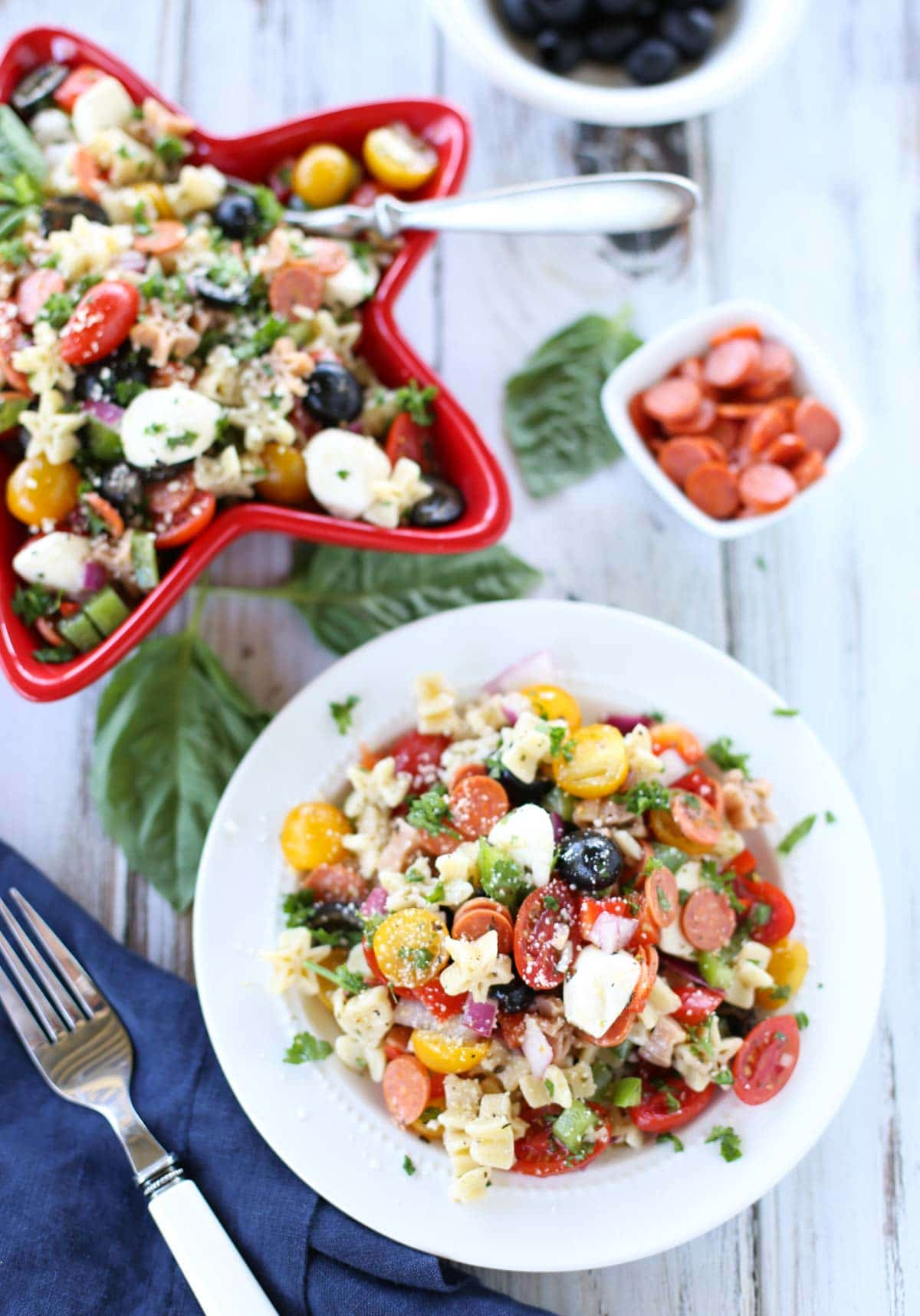 Supreme Pizza Pasta Salad   Delish combo of your favorite pizza ingredients! A simple side dish to any summer menu. Yum! The vinaigrette dressing ties it all together!   WorldofPastabilities.com