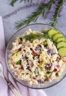 Tzatziki Pasta Salad | Cool and tangy Tzatziki Pasta Salad is the perfect side for a hot summer night! Artichokes, sun dried tomatoes, Kalamata olives, and crunchy cucumbers add just the right Greek flavors. Yum! Serve with grilled meats or chicken! Enjoy! | WorldofPastabilities.com
