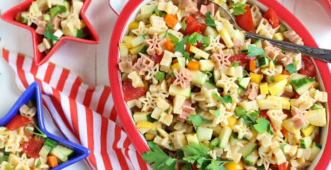 Fresh & Light Veggie Pasta Salad with Spicy Lemon Dressing | A light but flavorful dish featuring diced veggies and delicious pasta! Great with grilled meats or BBQ | WorldofPastabilities.com