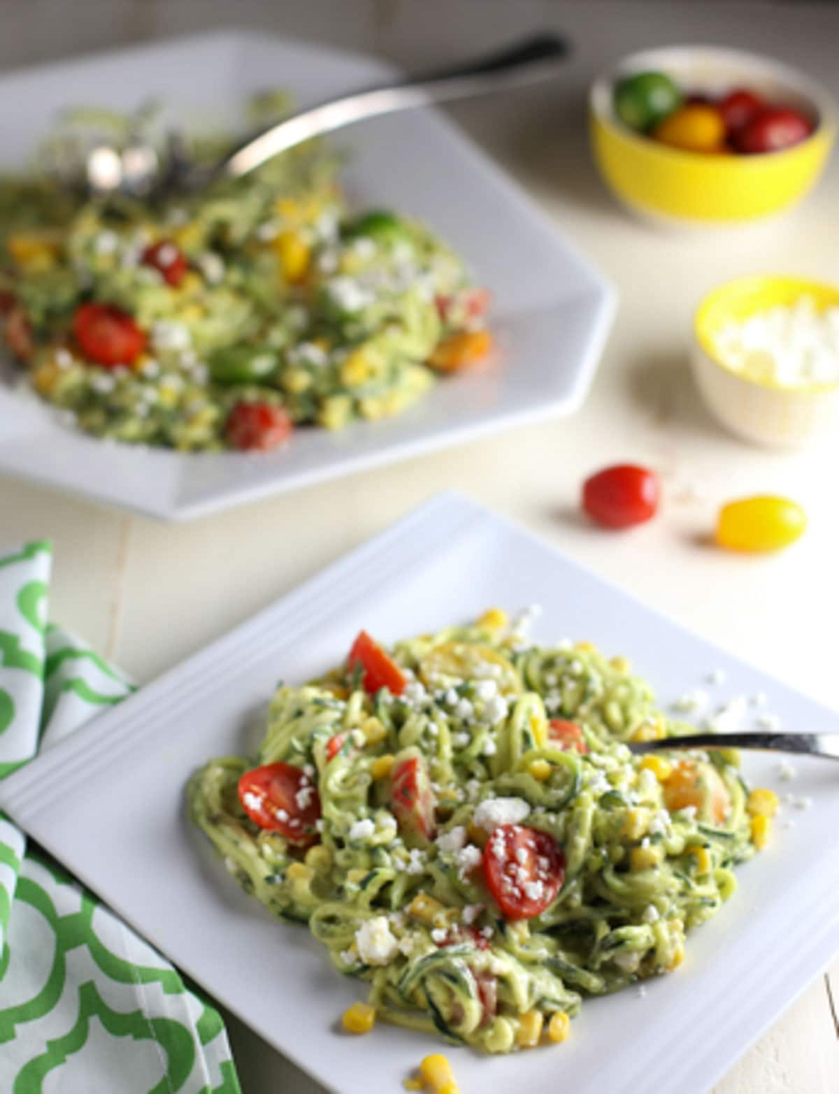 Zucchini Noodle Salad with Tomatoes, Goat Cheese, Corn & Avocado Sauce   WorldofPastabilities.com   Healthy, fresh, and delicious noodles that will convince even the kids it is pasta! The avocado sauce is the star...perfect side for any grilled meats this spring and summer!