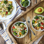 Blue Cheese Pasta Salad | Your favorite blue cheese veggies like cherry tomatoes and crunchy broccoli with toasted almonds and avocado! All tossed in a yummy blue cheese vinaigrette. Substitute feta for a lighter taste. Yum! | WorldofPastabilities.com