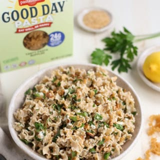 Toasted Nut and Feta Pasta in Bowl next to Good Day Pasta Box