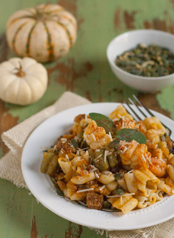 Italian Sausage and Pumpkin Pasta combines delicious fall flavors and textures. Pumpkin, Italian sausage, coconut milk, and spices create a hearty yet light pasta! Your tastebuds will love it! | WorldofPastabilities.com